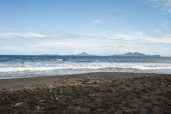 Black sand beach. Volcanic sand beach at Caribbean island Stock Image