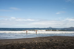 Black sand beach. Volcanic sand beach at Caribbean island Royalty Free Stock Photo
