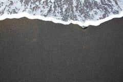 Black sand beach with wave foam Fuerteventura Royalty Free Stock Photos