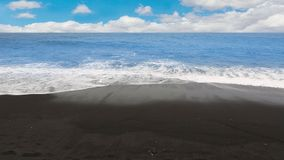 Black sand beach waves volcanic in Tenerife at Canary Islands stock video footage