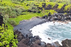 Black sand beack on Maui royalty free stock photography