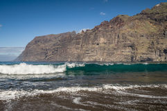 Black sand and big waves at Los Guios beach near Los Gigantes Royalty Free Stock Images