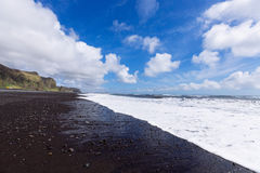 Black sand coast Stock Photography