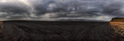 Black Sand Desert in Iceland. Panorama Photo. Cloudy Sky. Hjorleifshofdi. Stock Photos