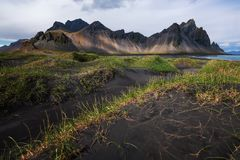 Black sand dunes with the Vestrahorn Batman Mountain in summer ,Iceland. Stock Photo