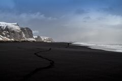 Black Sand Seashore Beside Snow Covered Mountain Royalty Free Stock Photos
