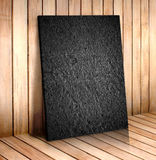 Black sand stone in wooden room,mock up for your content Stock Images