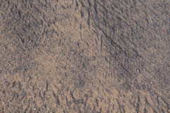 Black sand texture. Black sand background on sea beach in macao Royalty Free Stock Images