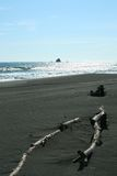 Black sand. Volcanic sand beach. Pacific ocean, east coast of peninsula Kamchatcka Stock Photos