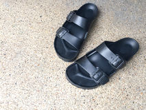 Black Sandal on ground Stock Image