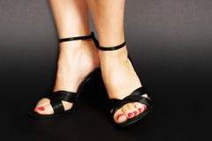black sandals royaltyfri bild