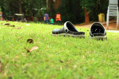 Black Sandals on the lawn. A Black Sandals on the lawn Royalty Free Stock Images