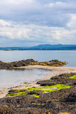 Black Sands beach, Aberdour, Scotland. Royalty Free Stock Images