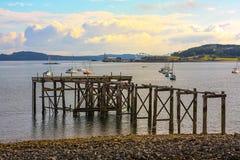 Hawcraig Pier, Aberdour. Scotland. Hawcraig Pier and boars sailing on a beautiful summer day, Aberdour. Scotland, United Kingdom stock image