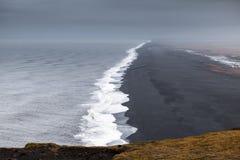 Black sands, North Atlantic Ocean coast. Dyrholaey Nature Reserve, south coast of Iceland, Europe stock image
