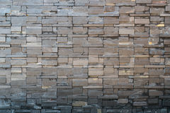Black sandstone tile wall decoration. For background Royalty Free Stock Photos