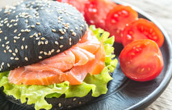 Black sandwich with salmon. And cream cheese royalty free stock photos