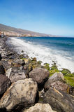 Black sandy beach in famous Candelaria town in Tenerife, Canary Island, Spain. . Stock Photo
