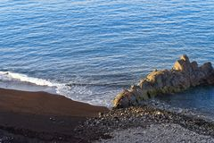 Black sandy beach and rocky formation on the Praia Formosa. Portuguese island of Madeira. Black sandy beach and rocky formation on the Praia Formosa - famous royalty free stock image