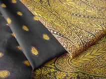 Black saree. A folded Black and yellow saree/sari with beautiful embroidery royalty free stock photos