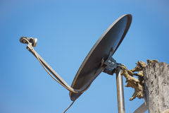 Black satellite antenna dish on the roof Stock Photography