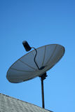 Black Satellite Dish Against A Blue Sky Royalty Free Stock Photo