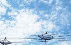 Black Satellite dish on beautiful sky. Black Satellite dish on a beautiful sky day Stock Image