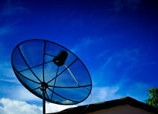 Black satellite dish with blue sky Stock Image