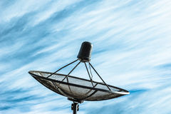 Black satellite dish in blue sky,filter effect Stock Images