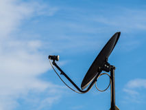 Black Satellite dish in the blue sky Stock Photo