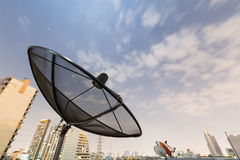 Black Satellite dish. And moving sky Royalty Free Stock Photography