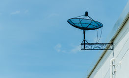Black satellite dish on roof Royalty Free Stock Photo