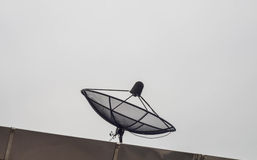 Black satellite dish on the roof. Royalty Free Stock Photos
