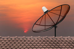 Black Satellite dish. Black Satellite dish on sunset background Stock Photo