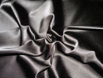 Black satin. Black rough satin textures suitable as background Royalty Free Stock Photography