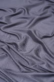 Black satin background Stock Images