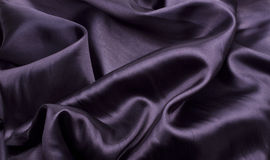 Black satin. Black silk background or texture Royalty Free Stock Images
