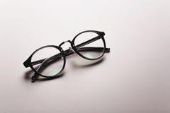 Black satine plastic circle eye glasses Royalty Free Stock Image