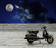 Black scooter parking with full moon Royalty Free Stock Images