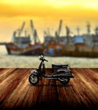 Black scooter parking beside jetty Stock Photo