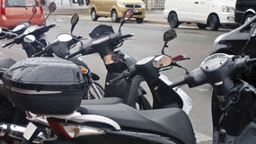 Black Scooters in the Rain Stock Photos