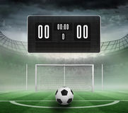 Black scoreboard with no score and football Stock Photography