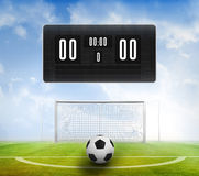 Black scoreboard with no score and football Royalty Free Stock Photography