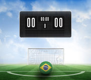 Black scoreboard with no score and football Royalty Free Stock Photos