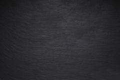 Black scratched grunge stucco wall background or texture Stock Photography