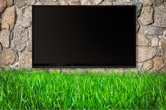 Black screen on the wall of stone Stock Image