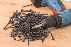 Black screws and screwdriver Royalty Free Stock Image