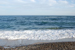 Black Sea. Rocky shore washed by the waves of the Black Sea Royalty Free Stock Image