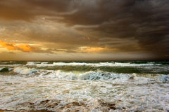 Black sea. SUNRISE-Black sea- It starts the new day. The sun punctures a road for itself in its oort clouds.Sunrise above the sea Stock Photos