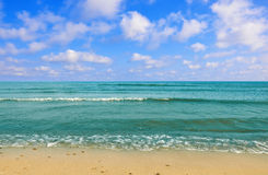 Black sea beach blue sky sand sun daylight Royalty Free Stock Photography